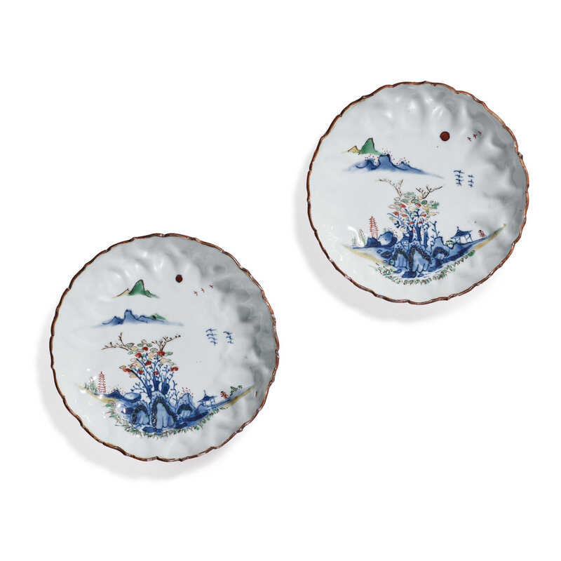A pair of wucai 'landscape' barbed-rim saucers, Ming dynasty, Tianqi-Chongzhen period (1621-1644)