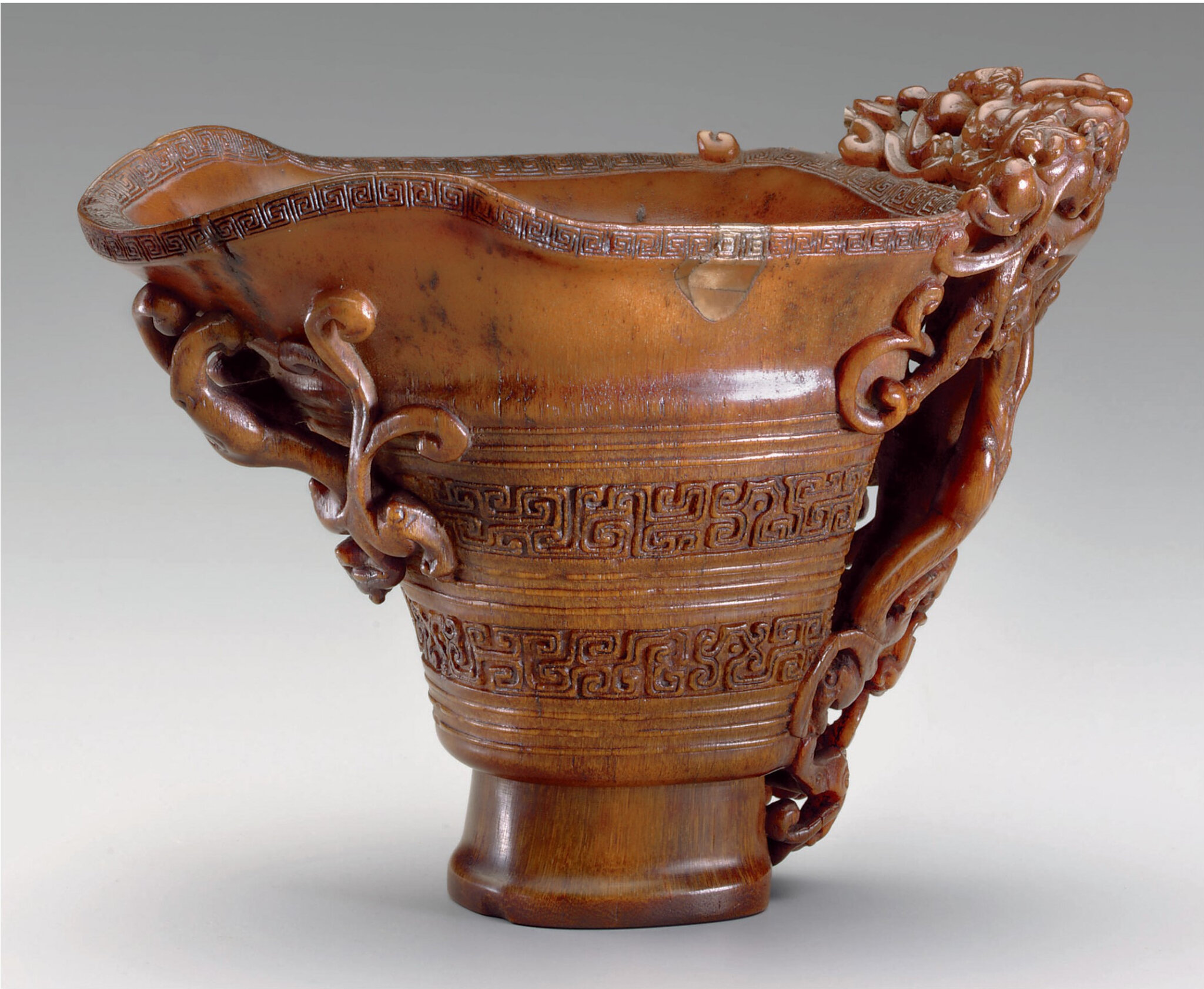 A finely carved signed rhinoceros horn cup, 18th century (2)