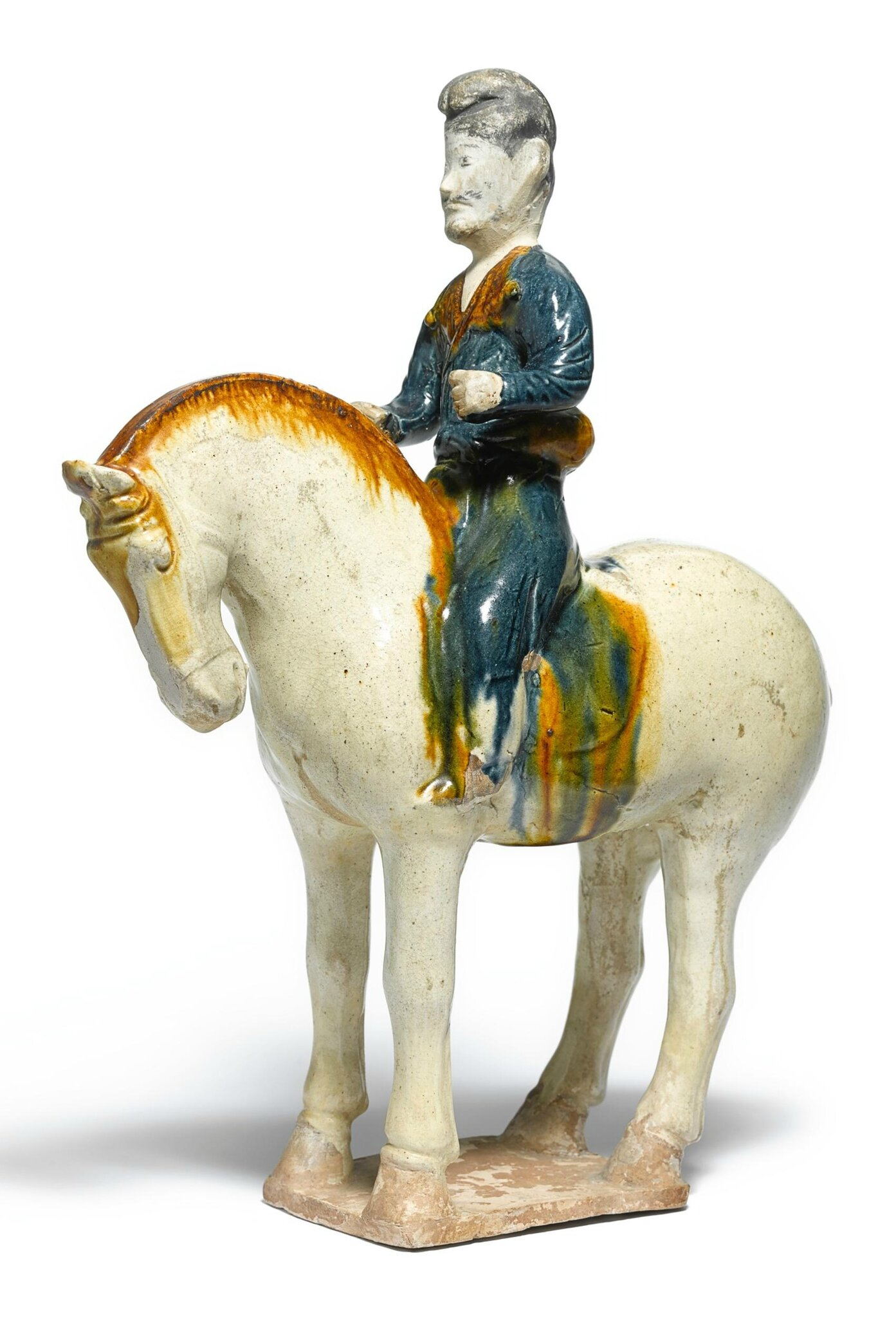 A rare sancai-glazed anf blue-glazed pottery figure of an equestrian, Tang dynasty (618-907)