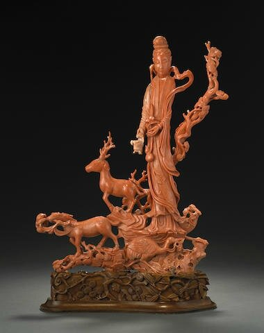 A massive coral figure of an Immortal, Late 19th-Early 20th century