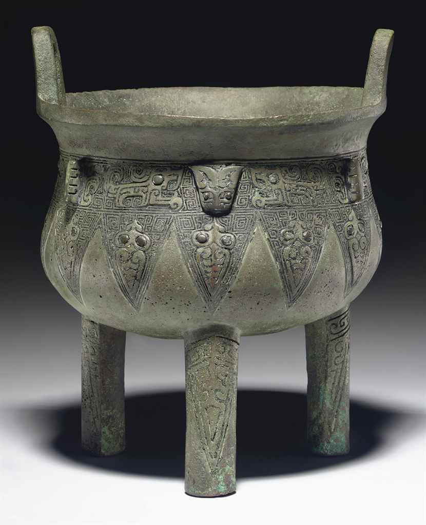 A small bronze ritual tripod food vessel, ding, Late Shang dynasty, 12th-11th century BC