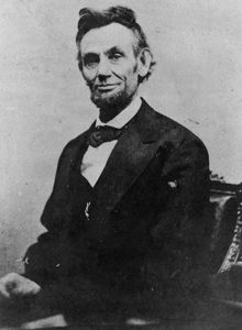 439px_Abraham_Lincoln_half_length_seated__April_10__1865