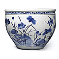 A large blue and white 'lotus pond' jardinière, qing dynasty, 18th century