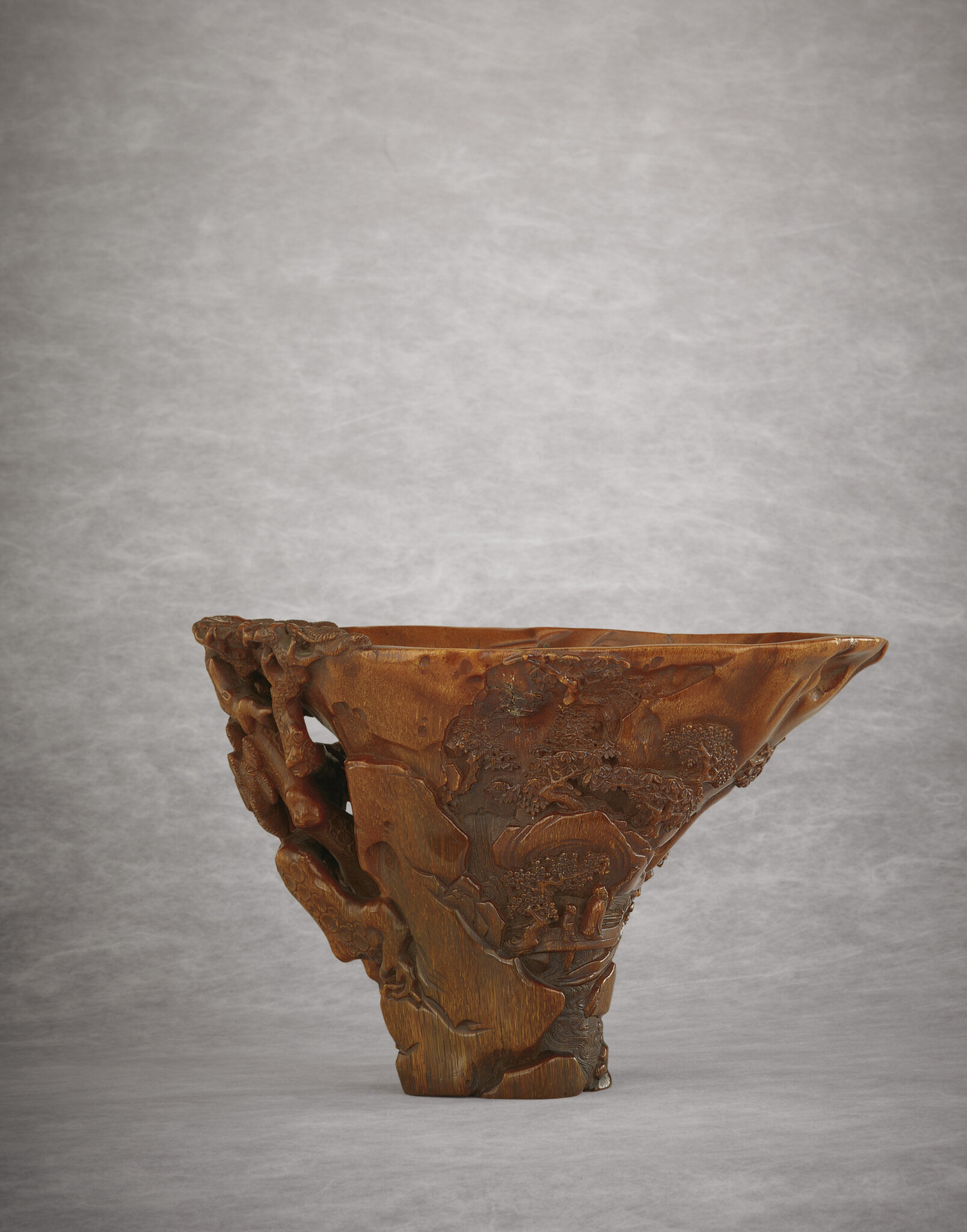 An exceptionally well-carved rhinoceros horn libation cup, Qing dynasty, 18th century