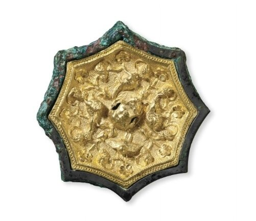A miniature gold sheet-inlaid bronze octafoil mirror, China, Tang dynasty (AD 618-907)
