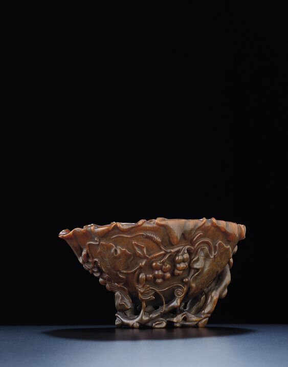 A large rhinoceros horn 'grape vine' libation cup, Qing dynasty, late 17th-18th century