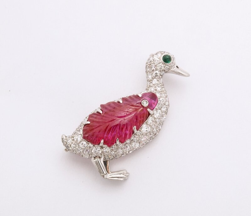 Pav__diamond_duck_brooch_with_carved_ruby_wing_and_a_cabochon_onyx_eye