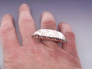 Silver_inlaid_copper_ring_on_hand