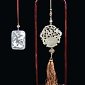 Two pendants, one in jade and one in agate, one of them has a wooden support, china, qing dynasty, 19th century