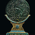 A spinach-green jade circular table screen and a cloisonné enamel stand, qing dynasty, qianlong period (1736-1795)