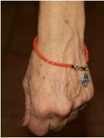 Bracelet en fil rouge du Medium Marabout DAH nassara-ilekambi