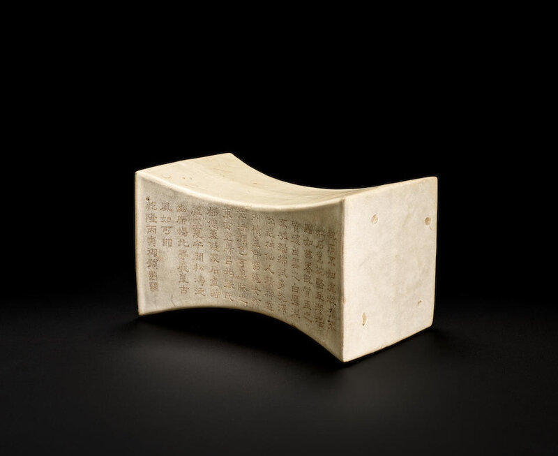 A rare imperially-inscribed white-glazed ingot-shaped pillow