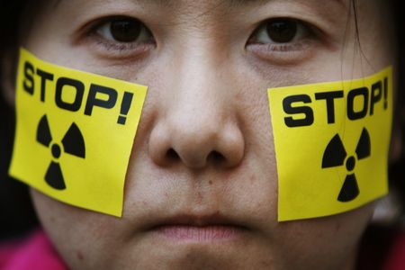 90244_an_anti_nuclear_protester_takes_part_in_a_rally_in_front_of_tokyo_elec