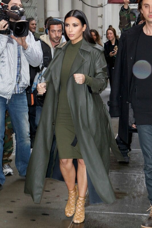 Kim-Kardashian-stepped-out-in-the-rainy-New-York-in-an-olive-bodycon-dress-with-a-matching-military-style-coat_-