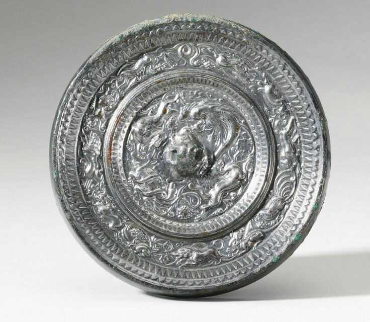 A BRONZE 'SPIRITS OF THE FOUR DIRECTIONS' MIRROR, SUI DYNASTY
