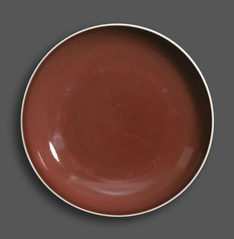 A copper red glazed deep dish, Qianlong six-character mark and of the period. Photo Bonhams
