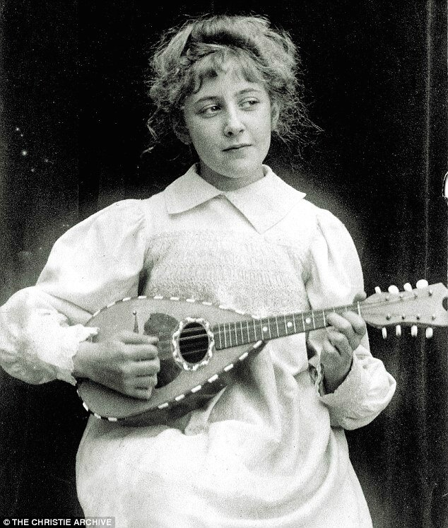 2B5CC96B00000578-3196470-The_young_Agatha_playing_the_mandolin_aged_8_in_1898_I_am_today_-a-3_1439576622404