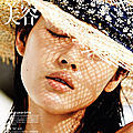 Editorial: 'a place in the sun' with liu wen by hans feurer for vogue china, june 2011