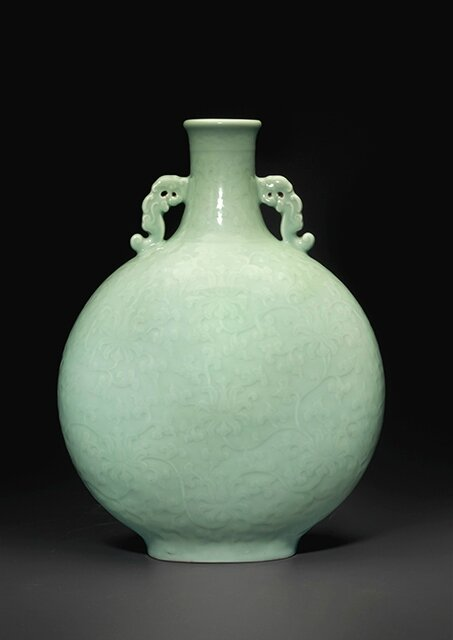 A magnificent and very rare large celadon-glazed carved moon flask, Qianlong six-character seal mark in underglaze blue and of the period (1736-1795)