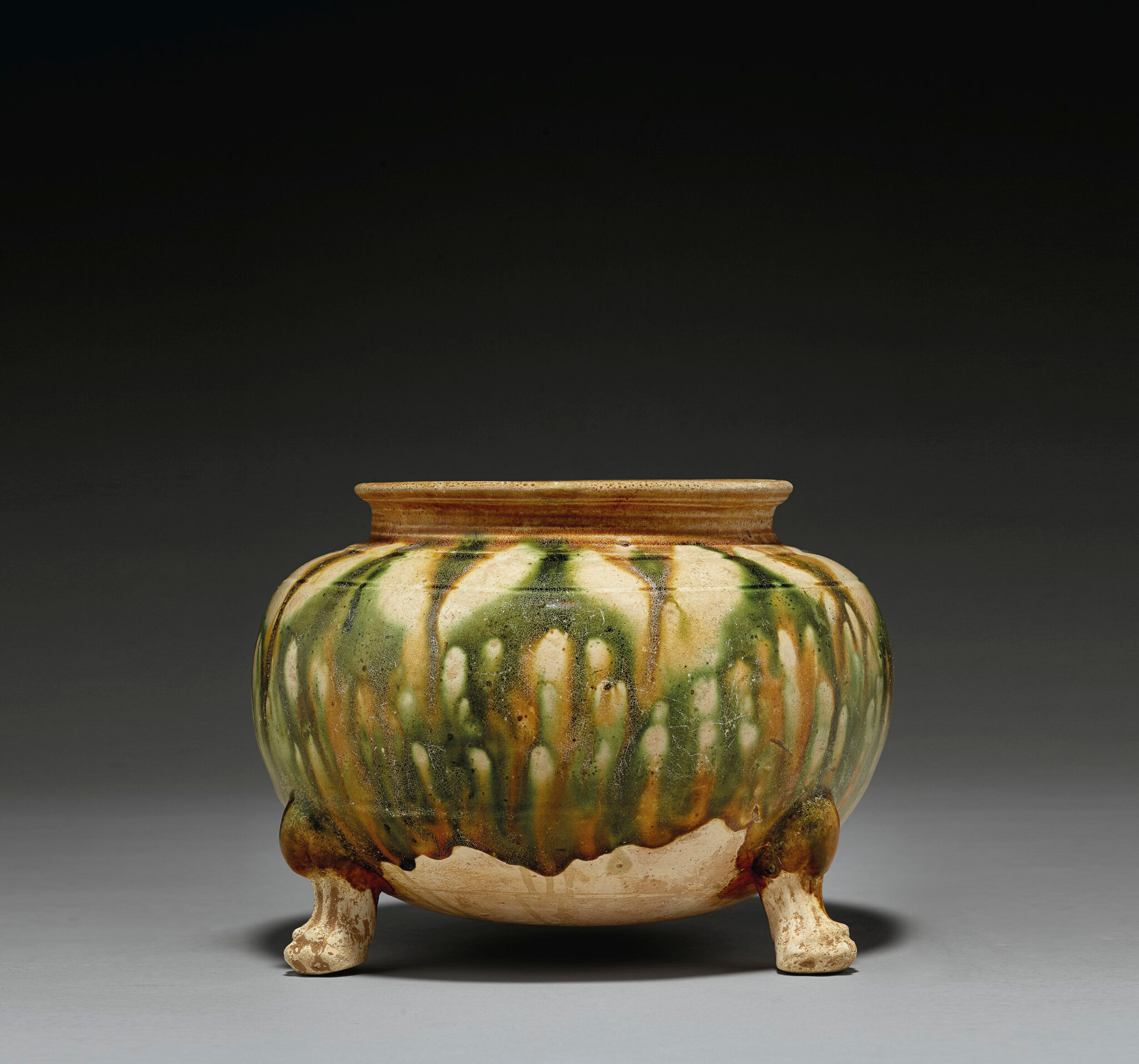 A sancai-glazed pottery tripod jar, Tang dynasty (618-907)