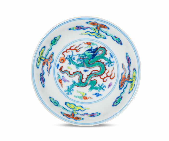 A fine and rare doucai 'dragon' saucer-dish, Yongzheng six-character mark and of the period (1723-1735)