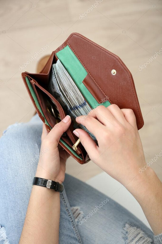 depositphotos_103101608-stock-photo-wallet-full-of-money