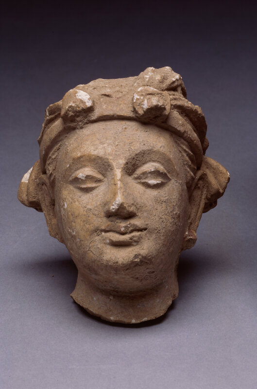 Head from temple near Rawalpini, ca. 300 BCE Clay 3 5/8 x 3 1/4 x 2 3/4 inches Ackland Art Museum, The University of North Carolina at Chapel Hill Gift of W. P. Jacocks 58.2.19