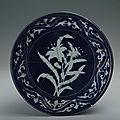Plate with the design of white plants against blue background, Xuande period (1426-1435)