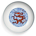An iron-red and underglaze-blue 'dragon' dish, qianlong seal mark and period (1736-1795)