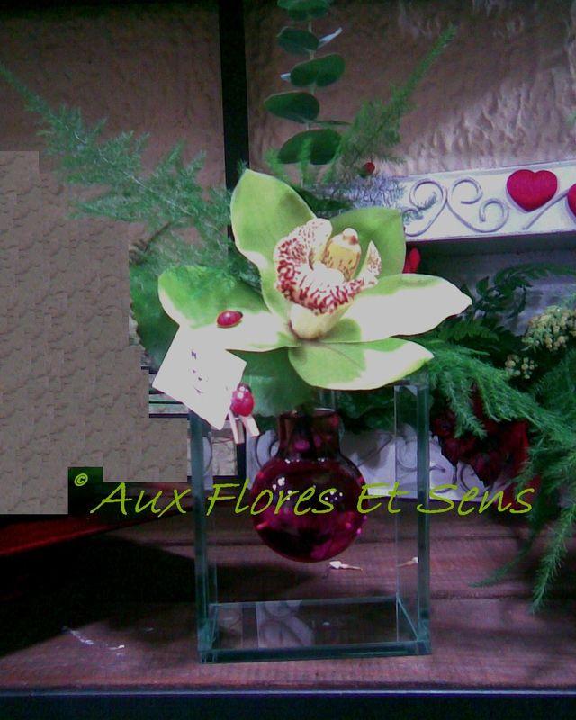 Fleuron Cymbidium dans vase fiole