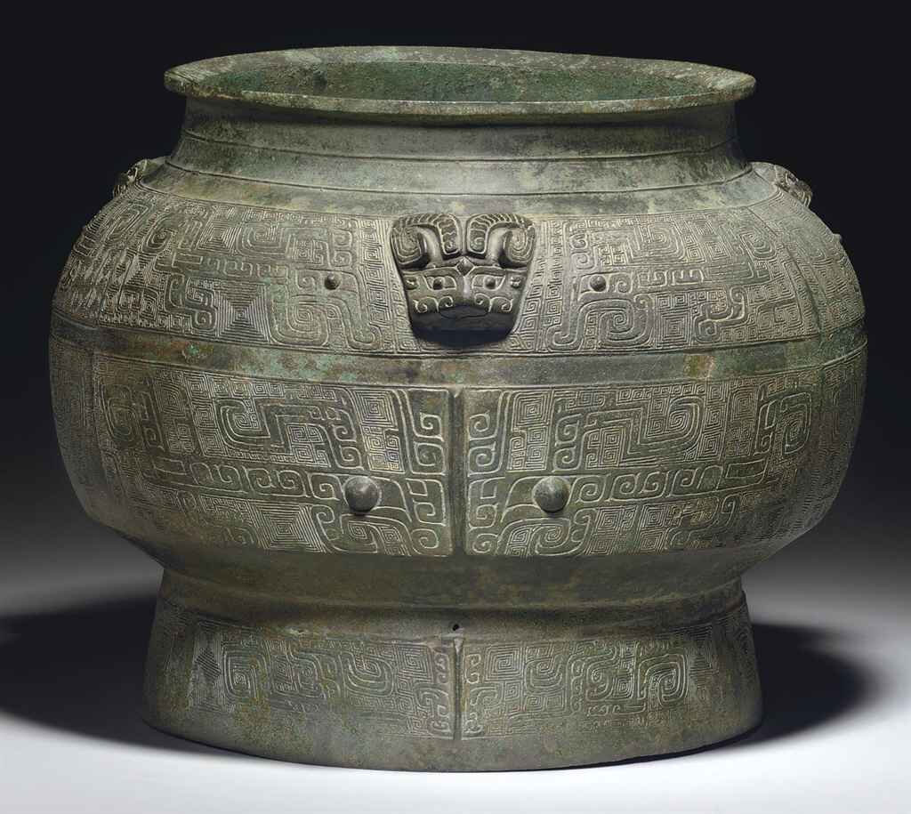 A rare and finely cast large ritual bronze wine vessel, pou, Shang dynasty, 11th century BC