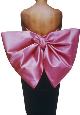 Yves_Saint_Laurent__Black_dress_w_pink_bow_photo_by_Gilles_Tapie