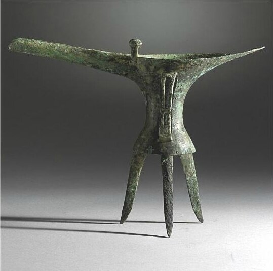 A rare early archaic bronze wine vessel, (jue), Erlitou Period, Shang Dynasty