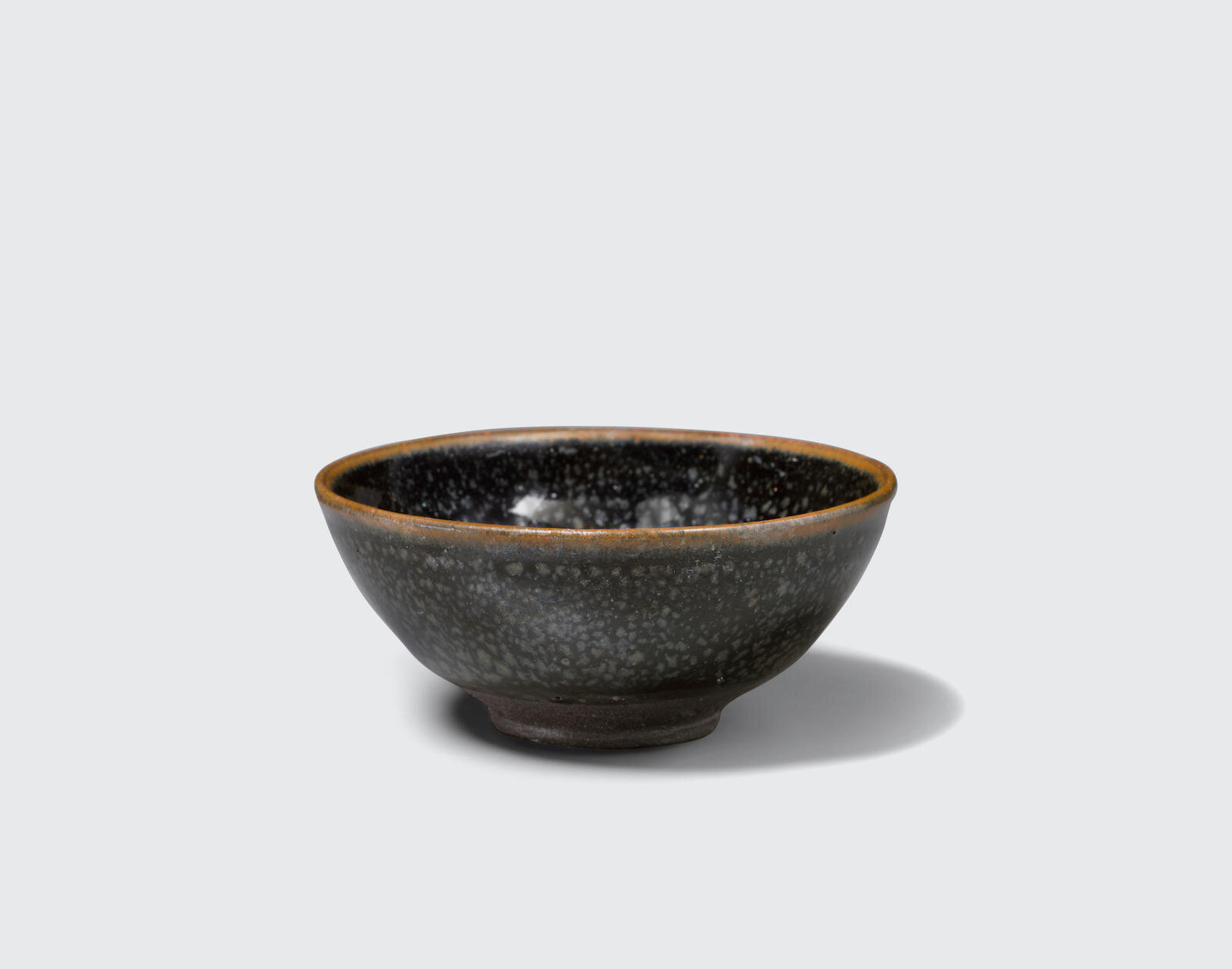 A small black glazed bowl with metallic 'oil spot' decoration, Jin dynasty (1115-1234)