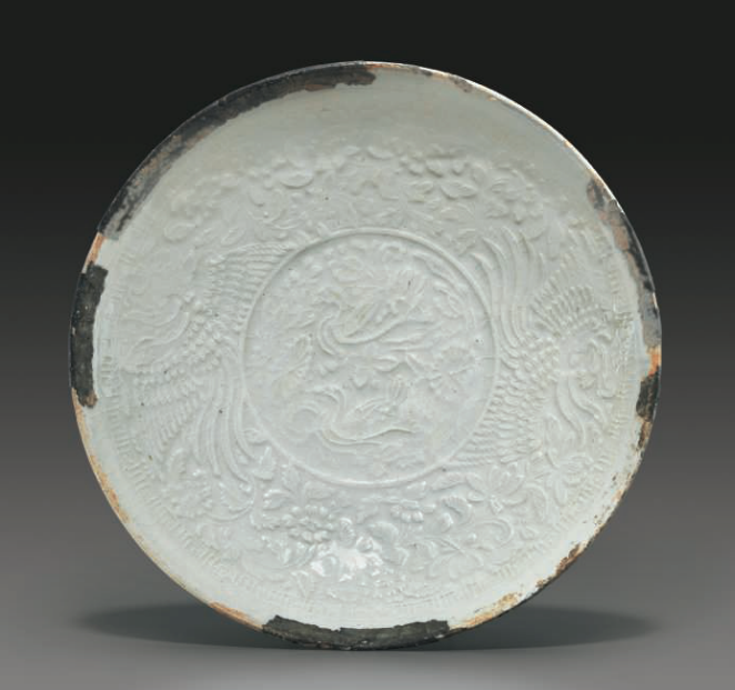 A molded Qingbai 'Phoenix' bowl, Southern Song Dynasty (1127-1279)