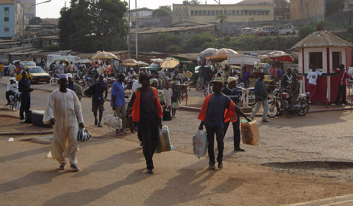 800px-Cameroon_-_Carriers_at_the_train_station_in_Yaounde-696x406