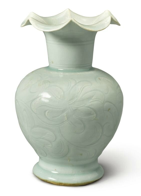 A carved Qingbai 'daylily' vase, Northern Song dynasty (960–1127)