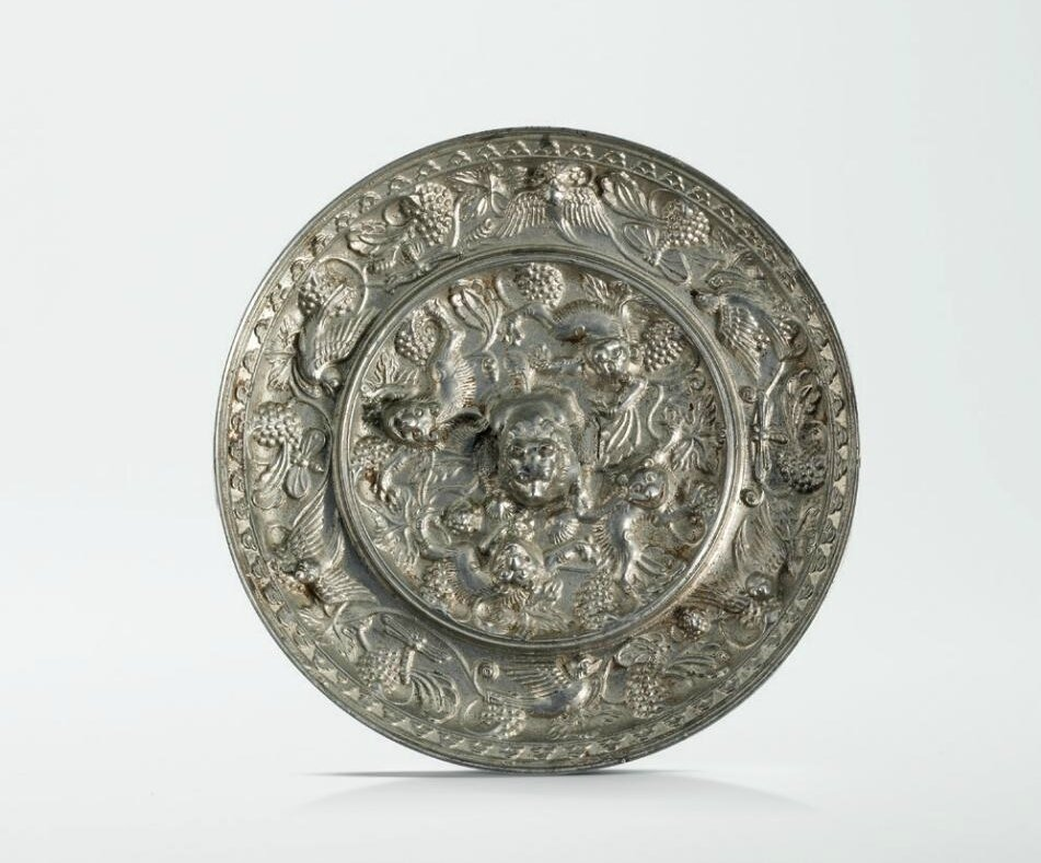 A bronze 'Lion and Grapevine' mirror, Tang dynasty (618-907)