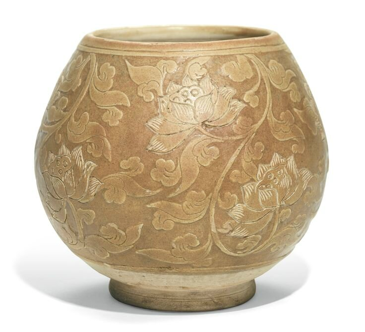 A rare 'Cizhou' 'lotus' jar, Northern Song dynasty