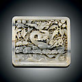 A rare white and grey jade openwork plaque, yuan dynasty (1279-1368)