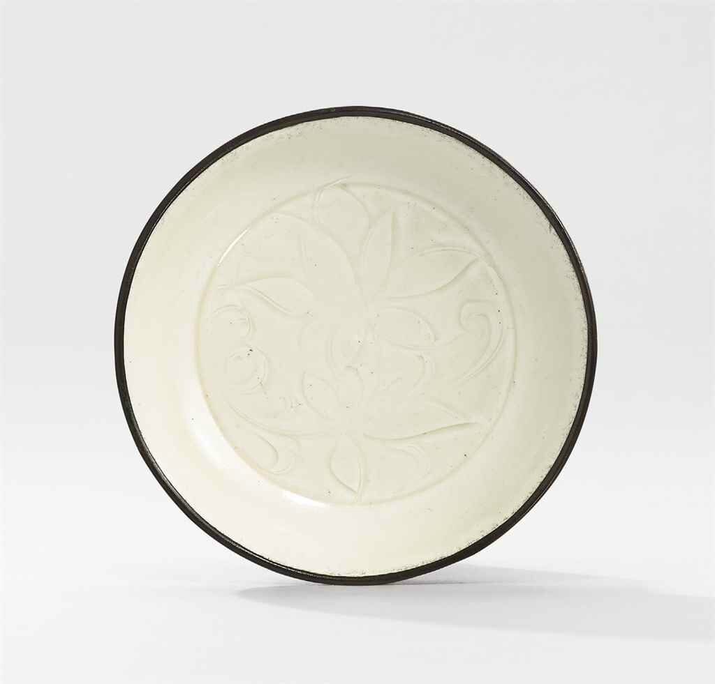 A small carved Ding 'lotus' dish, Northern Song dynasty (960-1127)