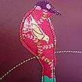 Le oiseau sur branche prune zoom