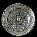 A rare large finely cast silvery bronze mirror, Sui dynasty (581-618)
