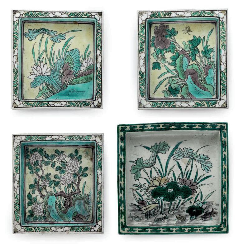 A group of four famille verte biscuit square dishes, China, Kangxi period (1662-1722)