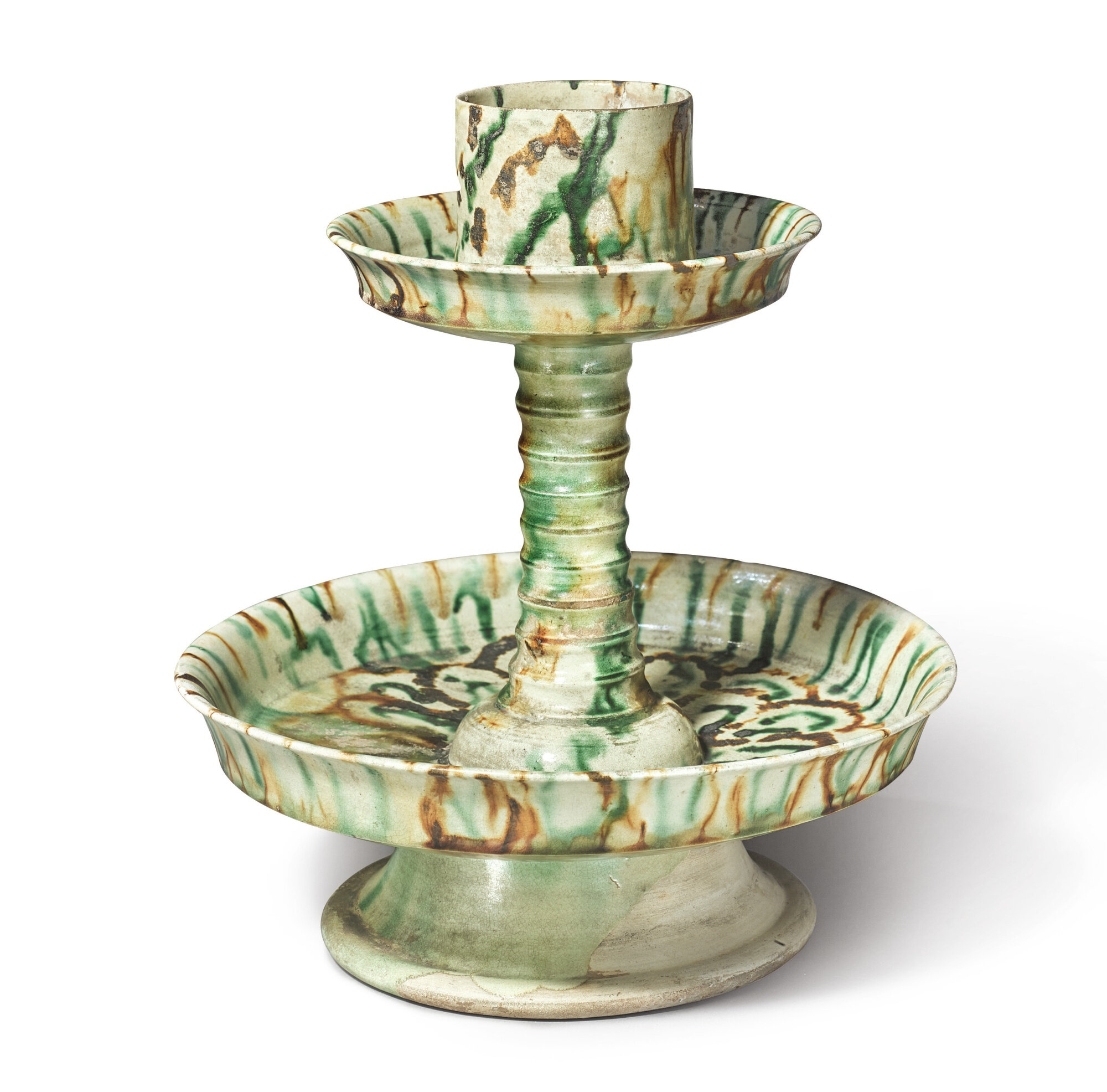 A rare sancai-glazed candle stand, Tang dynasty (618-907)