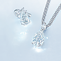 A diamond pendant necklace and a diamond ring