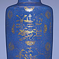 A gilt-decorated powder-blue ground rouleau vase, kangxi period (1662-1722)