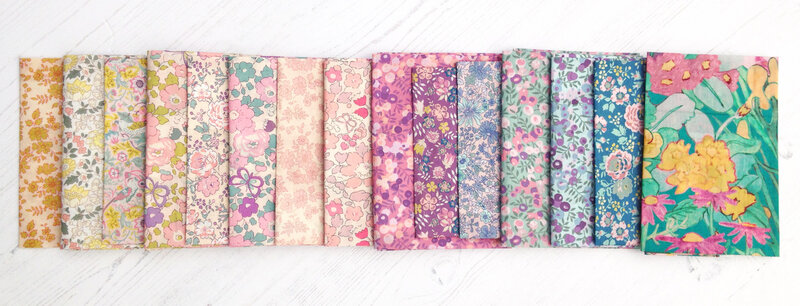 Alice Caroline Exclusives folded in rainbow order rectangle