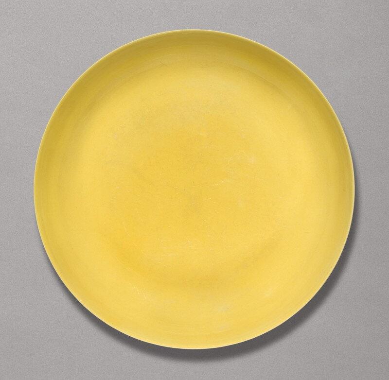 A yellow-glazed dish, Hongzhi mark and period (1488-1505)