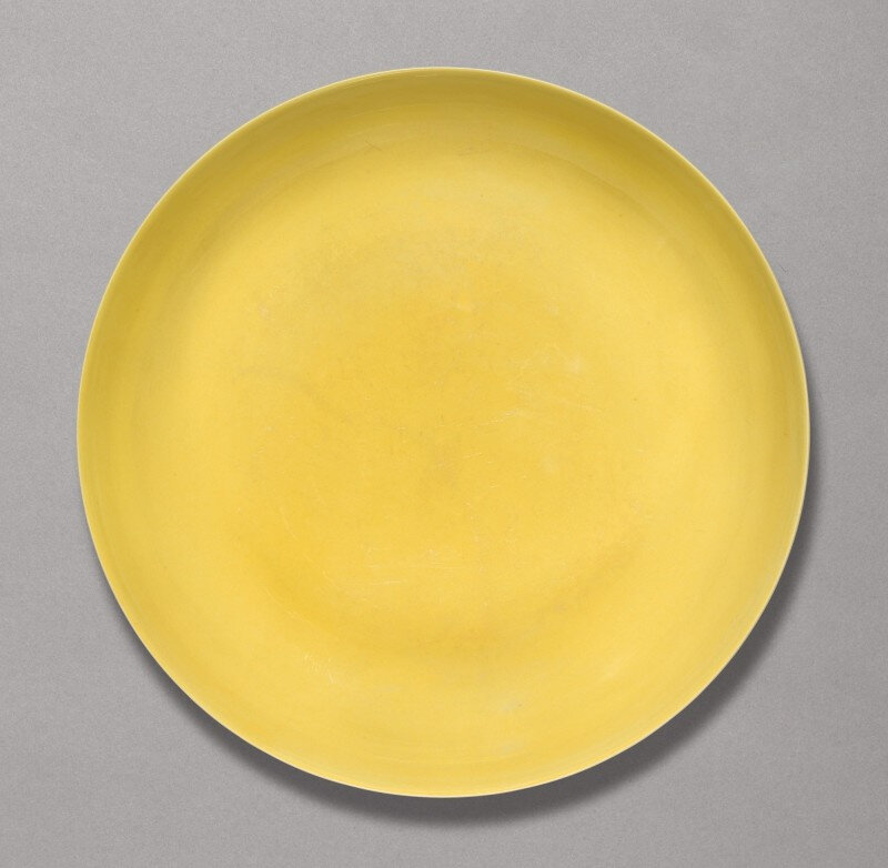 A yellow-glazed dish, Hongzhi mark and period (1488-1505)